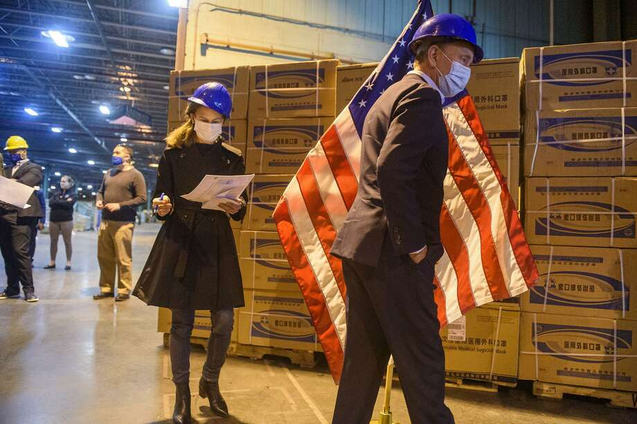 Gov. Ned Lamont and Lt. Gov. Susan Bysiewicz tour the State of Connecticut's commodities warehouse soon after receiving six million surgical masks, 500,000 protective masks, 100,000 surgical gowns and 100,000 thermometers -- nearly $15 million in all -- from China. (Mark Mirko/Hartford Courant/TNS) Photo: Mark Mirko / TNS / Hartford Courant