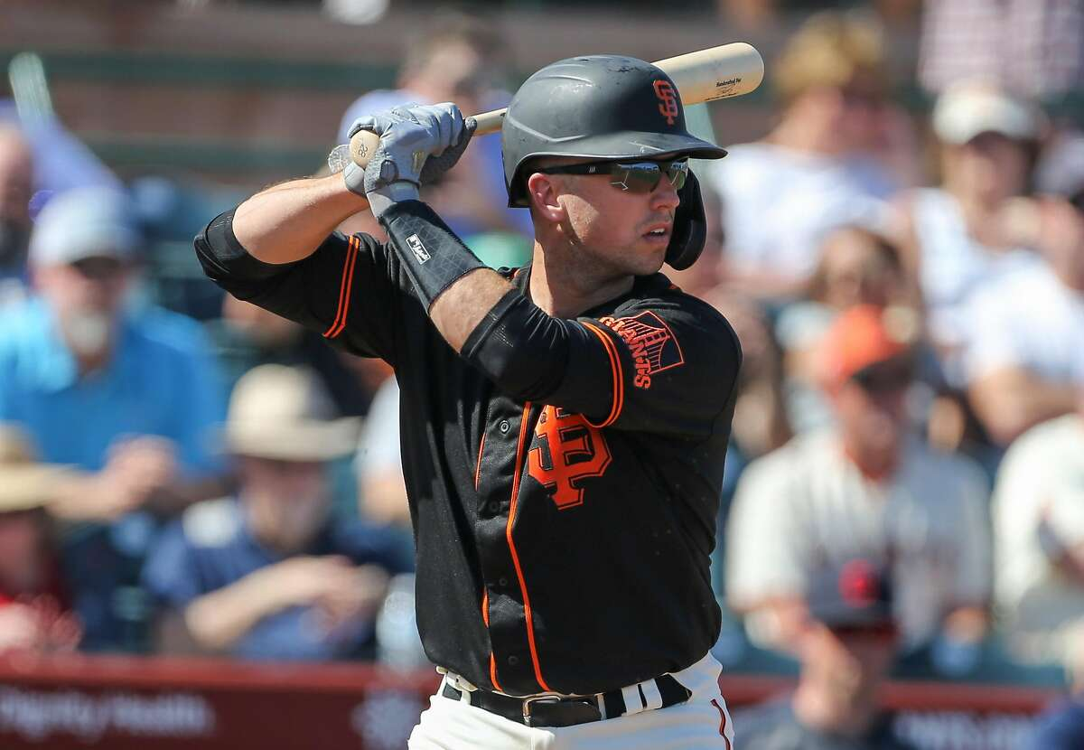 San Francisco Giants catcher Buster Posey waits for a pitch during their game with the Cleveland Indians at Scottsdale Stadium Thursday, March 5, 2020, in Scottsdale, Arizona.