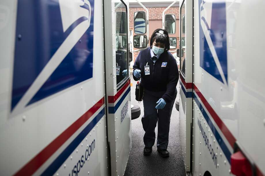 In this Wednesday, May 6, 2020, photo, United States Postal Service carrier Henrietta Dixon gets into her truck to deliver mail in Philadelphia. (AP Photo/Matt Rourke) Photo: Matt Rourke, Associated Press