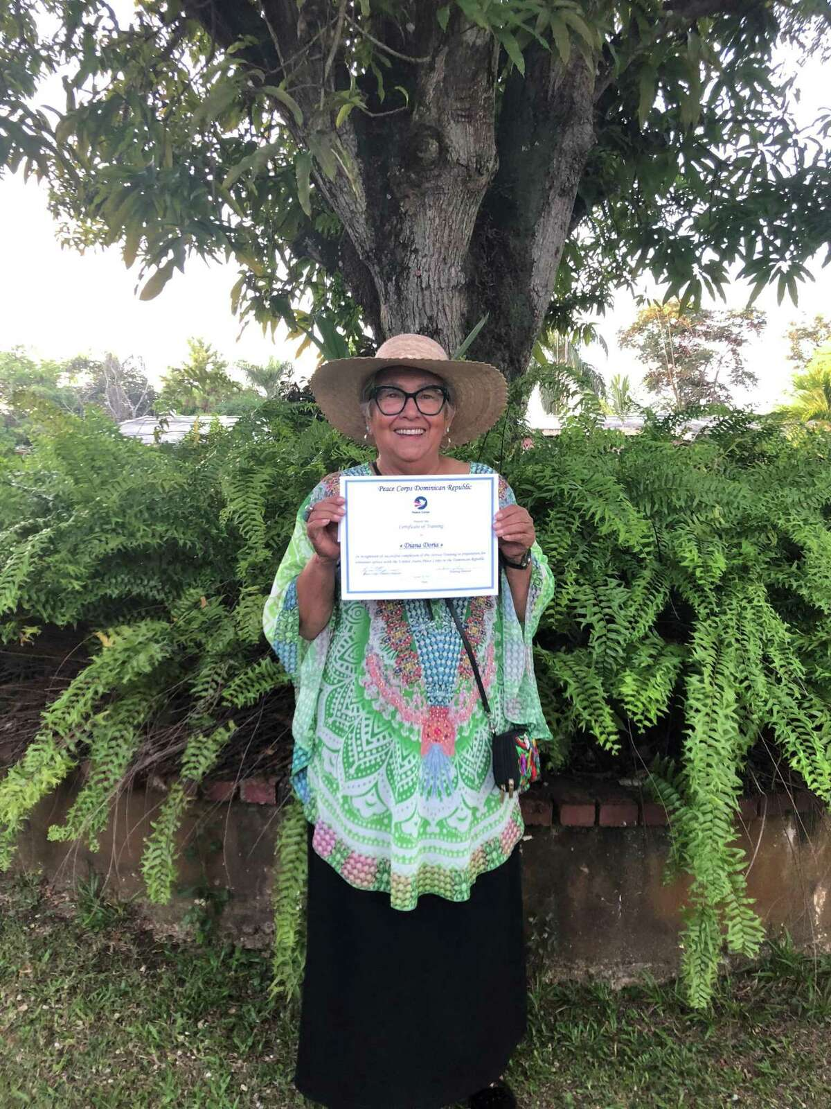 Peace Corps volunteer Diana Doria holds her certificate of completion in October 2019 after weeks of training in Santo Domingo, Dominican Republic. Doria was one of more than 7,000 volunteers recalled from 60 countries after the coronavirus outbreak.