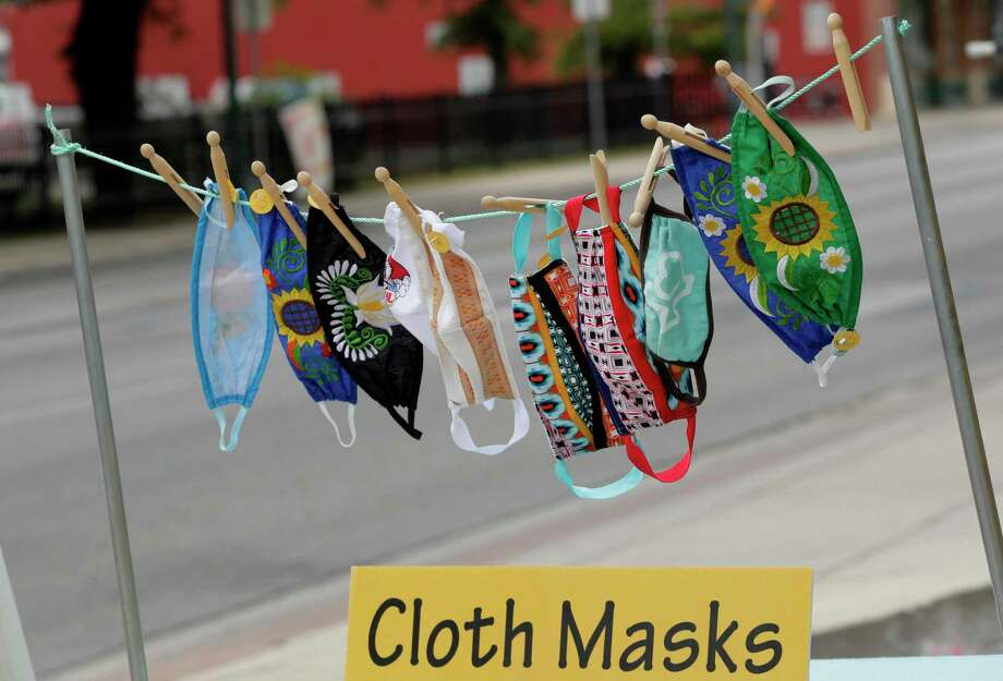 Homemade face masks for sale blow in the wind outside of a business in Texas on May 12. Midland continues to encourage face masks or coverings as well as social distancing in an an effort to fight the coronavirus pandemic. (AP Photo/Eric Gay) Photo: Eric Gay /Associated Press / Copyright 2020 The Associated Press. All rights reserved.