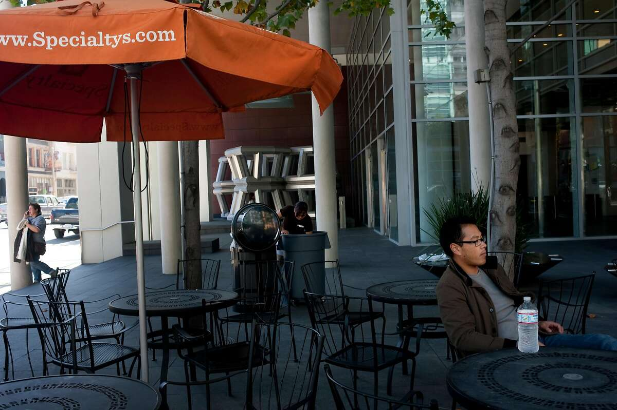 Gally Galgana (right) sits on the patio of Specialty's CafŽ & Bakery on Friday, October 7, 2011 in San Francisco, Calif. The 2-month-old cafe fills a retail space in the Foundry Square building that had previously been empty for eight years.