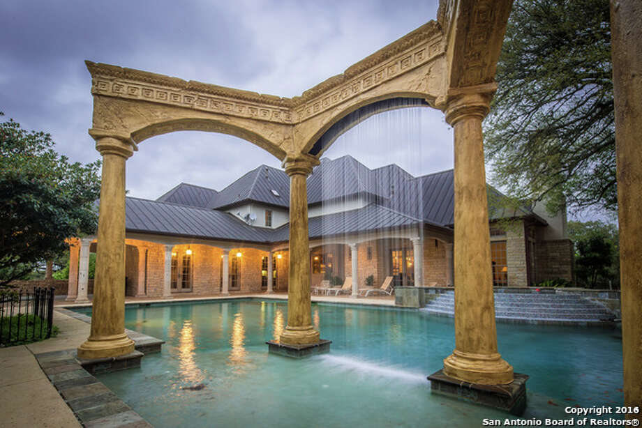 Waterfalls are a popular pool trend in Texas. They come in many different shapes and sizes, and can be constructed out of bricks, stones or other building materials. Photo: San Antonio Board Of Realtors