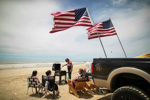 The Stratton family from Cypress enjoys the day barbecuing and playing games after weeks of isolation due to the COVID-19 outbreak on Sunday, May 17, 2020, in Bolivar Peninsula. When the family arrived to the beach they realized it was Go Topless Jeep Weekend.
