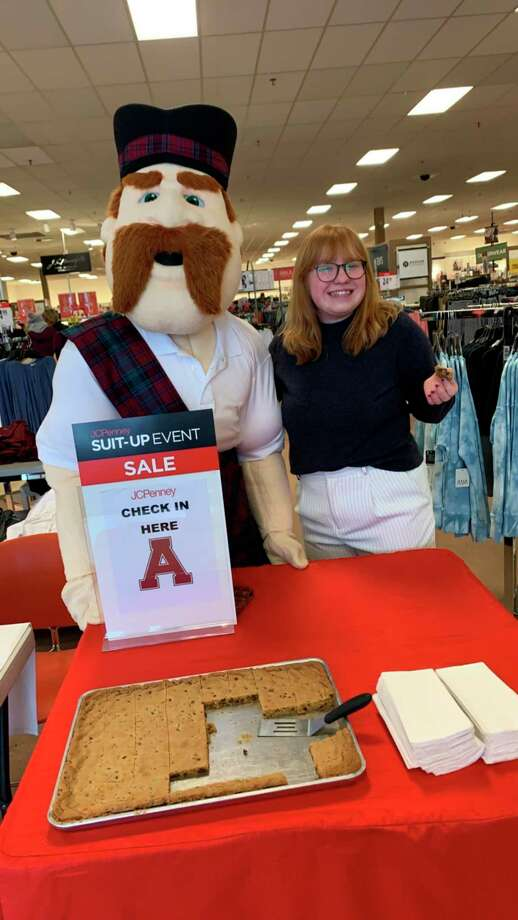 "Alma College class of 2020 graduate Bridget Flanery is pictured with the college mascot Scotty at ""Suit Up,"" a Career Week event in January. Like many graduates, Flanery's summer plans are in flux due to the COVID-19 pandemic. (Photo provided)"