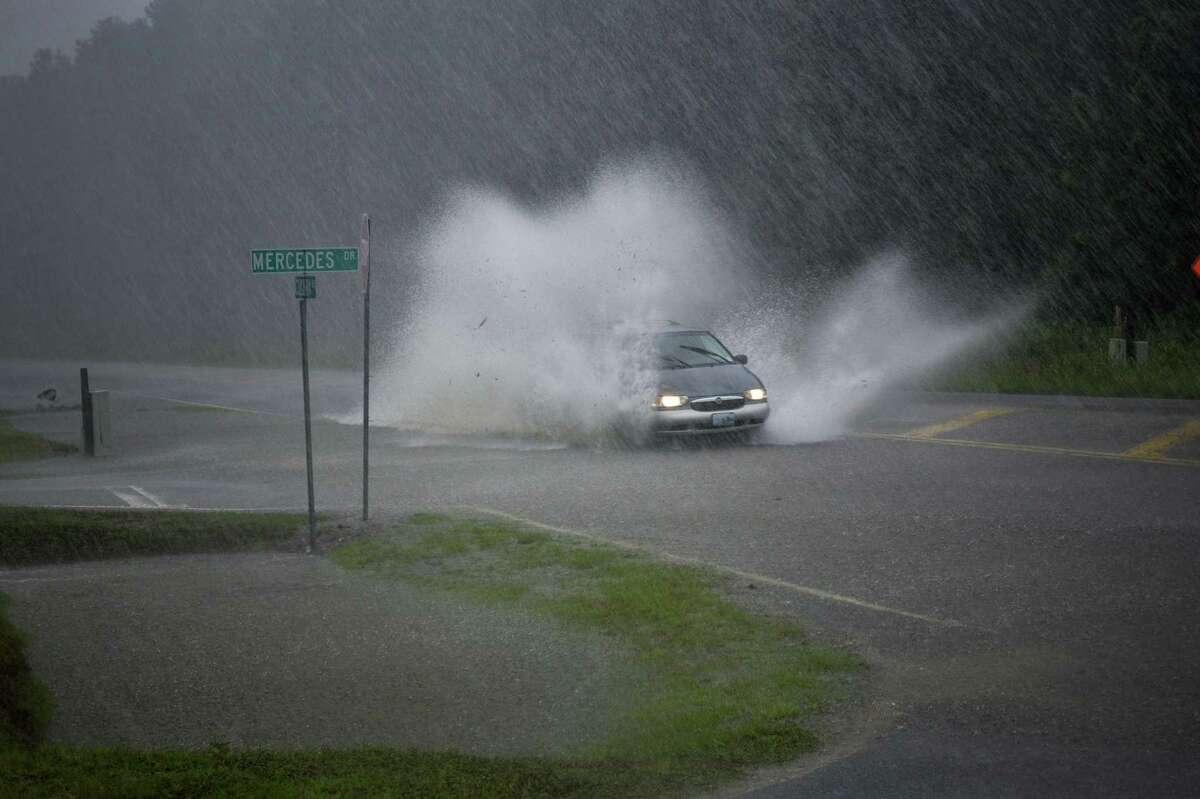 A vehicle drives through a flood during Hurricane Dorian in Conway, S.C., on Sept. 5, 2019.