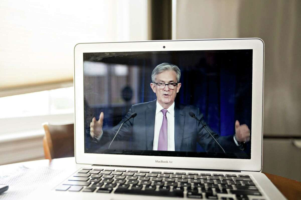 Jerome Powell, chairman of the U.S. Federal Reserve, speaks during a virtual news conference seen on a laptop computer in Arlington, Va., on April 29, 2020.