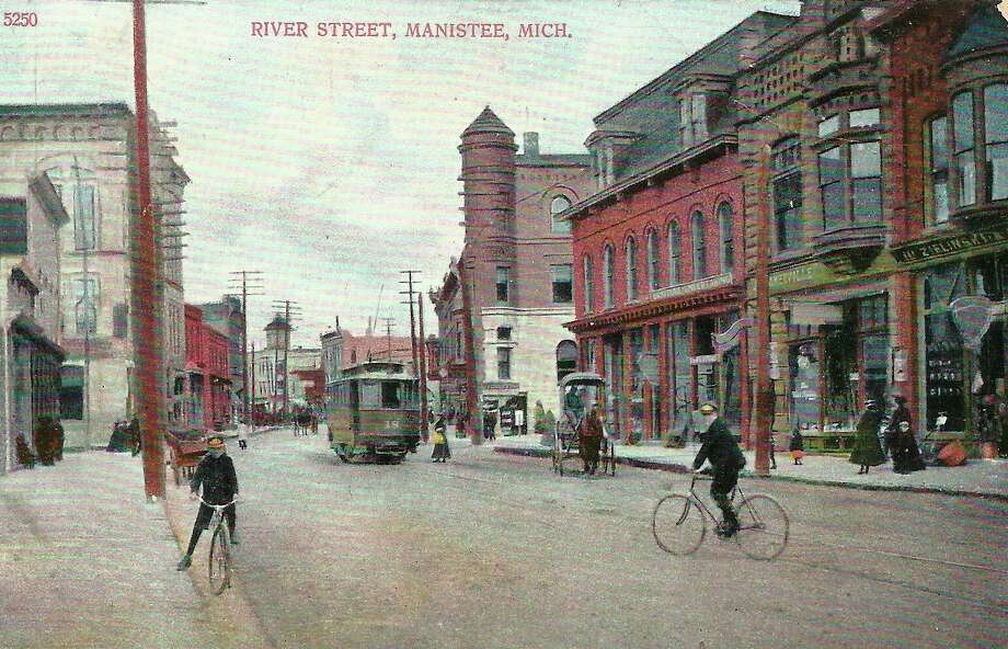 The modes of transportation on River Street in the early 1900s were bicycles, street cars and horse and buggy.