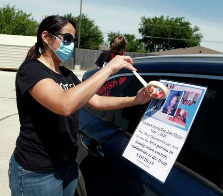 Rachael Tucker prepares her vehicle for the advocacy group car protest near the Karnes County Residential Center 409 FM1144, Karnes City, Texas, 78118. Advocacy groups are protesting family detention amid the pandemic, as coronavirus spreads rapidly through detention facilities across the country on Saturday, May 16, 2020.