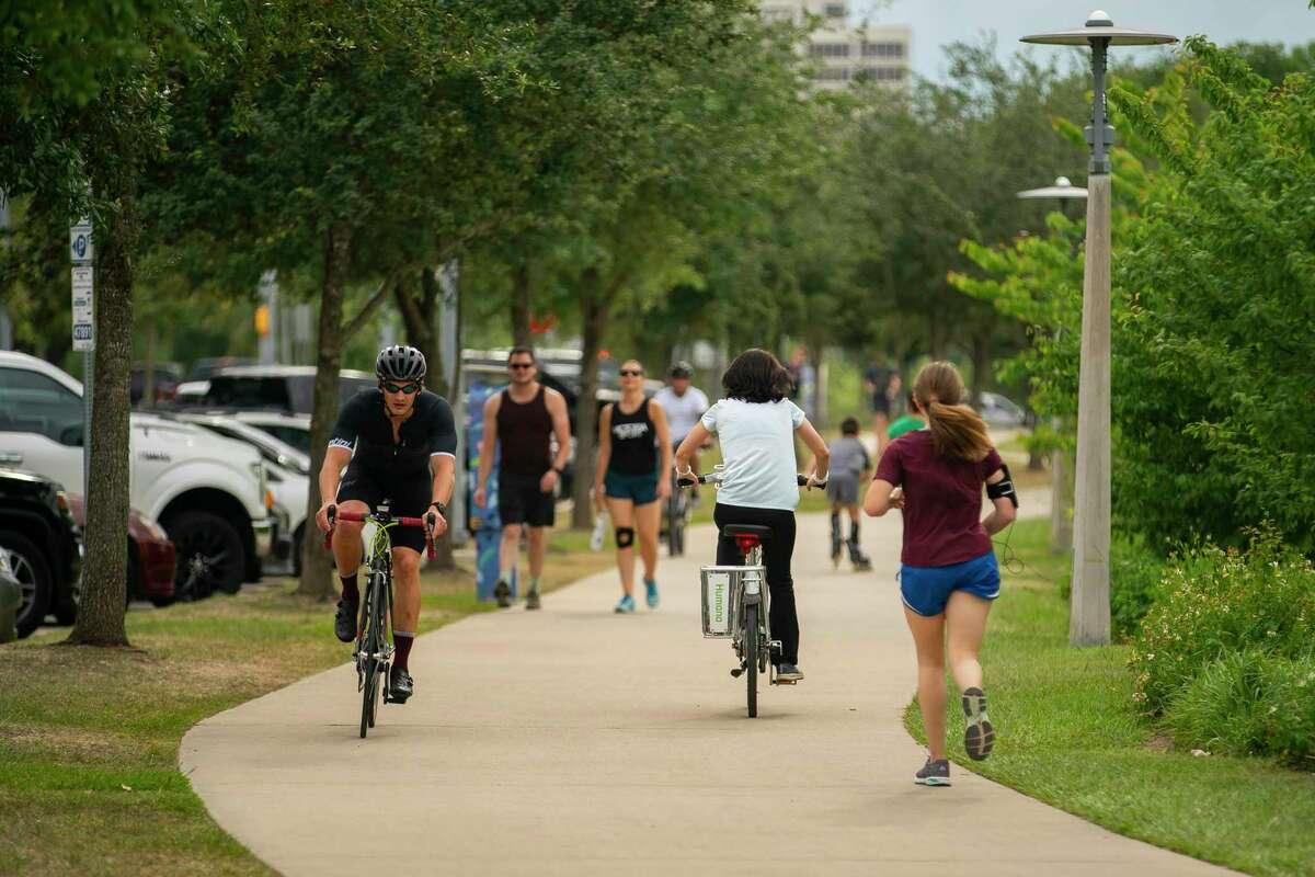 People enjoy mild weather along Buffalo Bayou near Eleanor Tinsley Park, Tuesday, May 12, 2020, near downtown Houston.