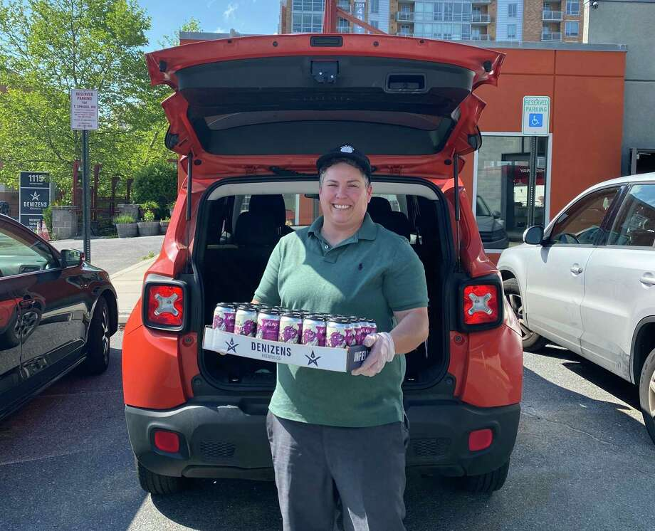Julie Verratti, one of the co-founders of Denizens Brewing Company in Silver Spring, Md., has been delivering beers while the taprooms are closed. Photo: Denizens Brewing Company / The Washington Post