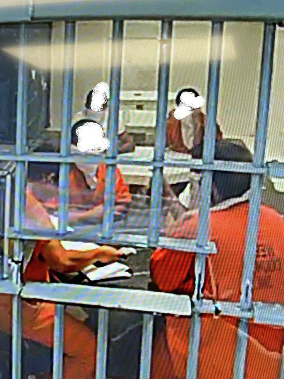 Webb County Jail inmates can be seen wearing bandanas as part of preventive actions against COVID-19 taken by the Webb County Sheriff's Office.