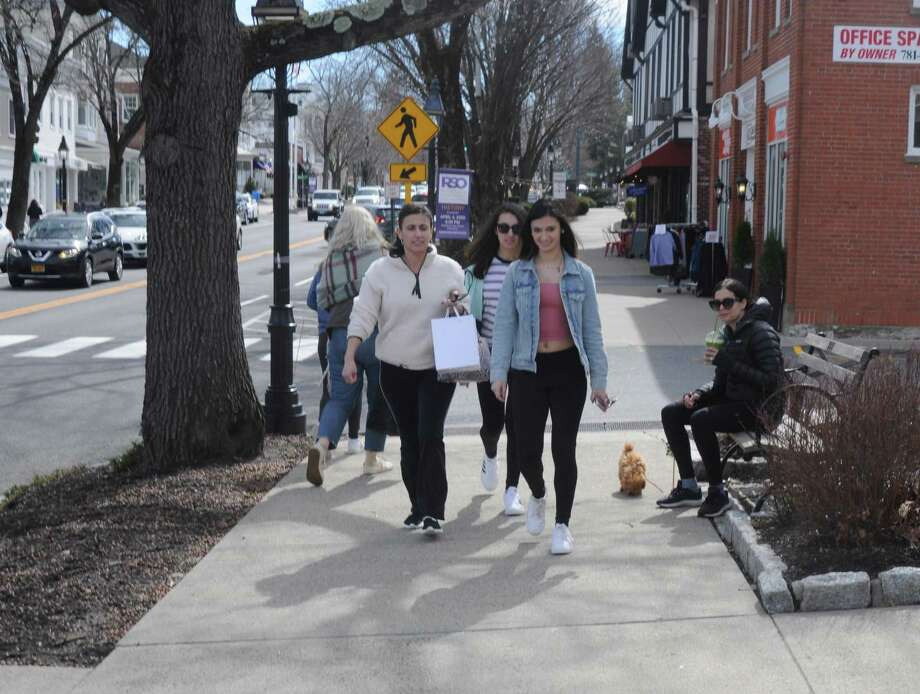 Shoppers were out on Main Street on Saturday March 14, just before the coronavirus lockdown, and the Ridgefield Reopens Committee has offered guidelines for when they return after reopening starts on Wednesday, May 20. Photo: Macklin Reid / Hearst Connecticut Media