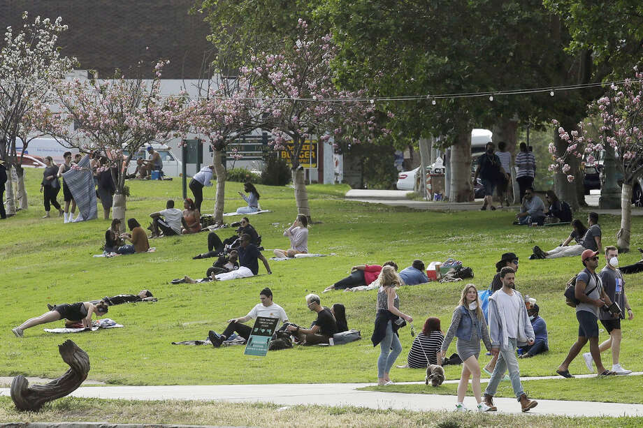 People visit Lake Merritt during the coronavirus outbreak in Oakland, Calif., Saturday, May 16, 2020. Photo: Jeff Chiu/Associated Press