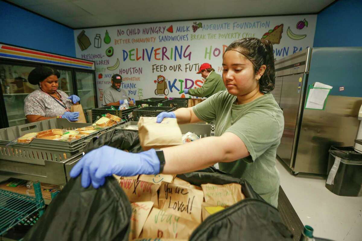 Joanne Jacob helps pack lunches for children at Kids Meals Inc, Tuesday, April 7, 2020, in Houston. Kids Meals Inc, a non-profit that delivers meals to pre-school age children who live in underserved communities.