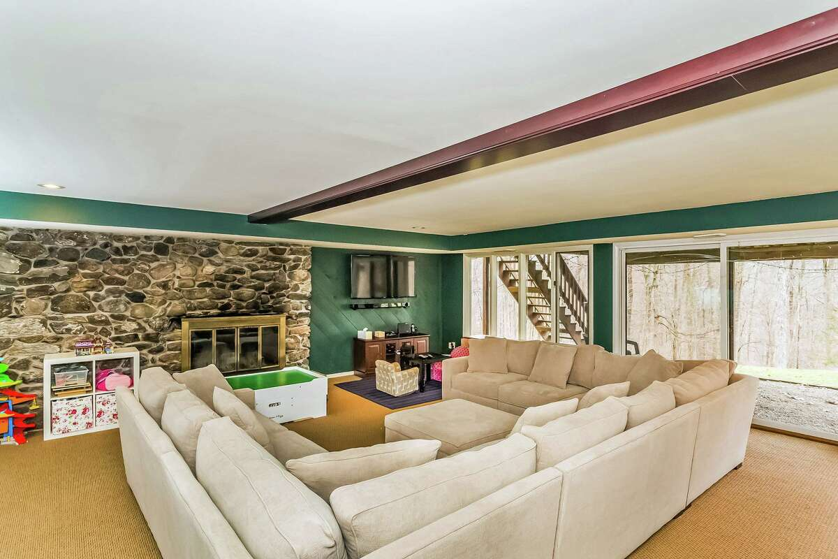 On the walk-out lower level there is a bedroom, game room, fireplace, wet bar, and full bath.