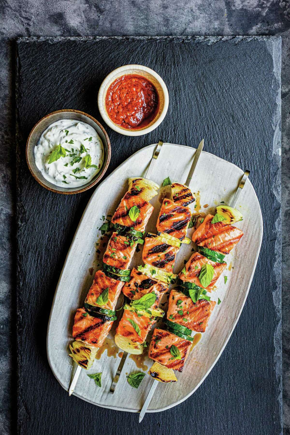 """Salmon Kebabs with Zucchini, Herbed Labneh & Harissa from """"The Indoor Grilling Cookbook"""" from Williams-Sonoma Test Kitchen."""