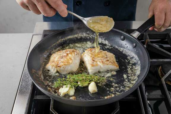 "Butter-Basted Fish Filet with Garlic and Thyme from ""Foolproof Fish"" by America's Test Kitchen."