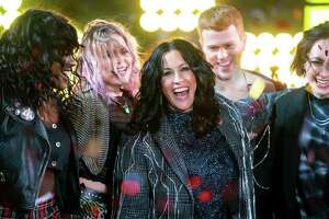 "Alanis Morissette celebrates New Year's Eve on Times Square with members of the ""Jagged Little Pill"" cast ."
