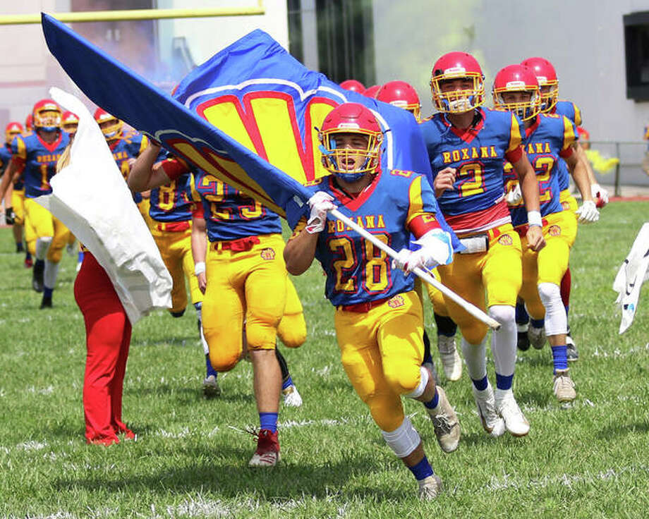 The Roxana Shells football team takes the field before a South Central Conference football game last season at Raich Field in Roxana. Roxana are EA-WR are considering offers to join the Cahokia Conference. Photo: Greg Shashack |Telegraph File Photo