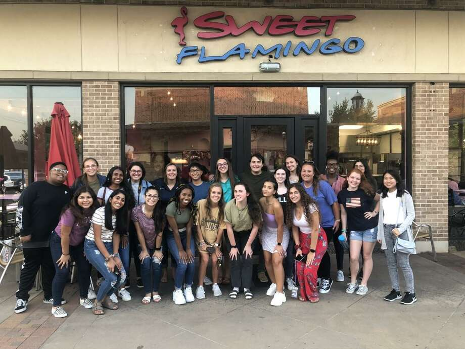 The yearbook and newspaper staffs at Seven Lakes High School in Katy pose for a photo at a social earlier this year. In March, they had to begin finishing all their work from home because of the COVID-19 pandemic. Photo: Courtesy Photo