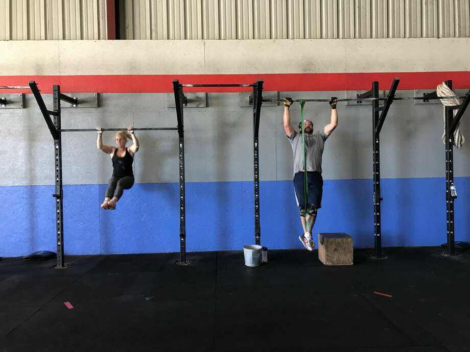 Beaumonters get a workout in at NorBeau CrossFit on May 18, 2020, the day Texas lifted coronavirus-related restrictions on gyms. Photo by Kim Brent/The Enterprise