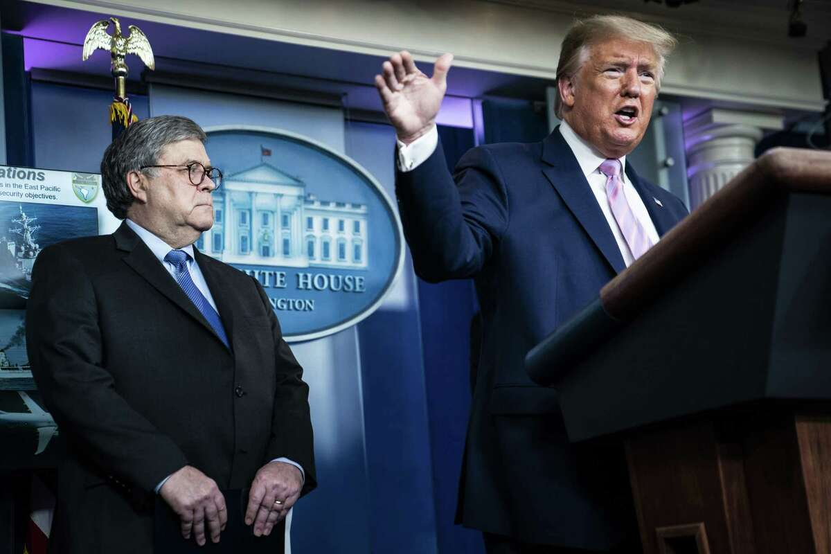 Attorney General William Barr listens as President Donald Trump speaks with members of the coronavirus task force during a briefing at the White House on April 1.