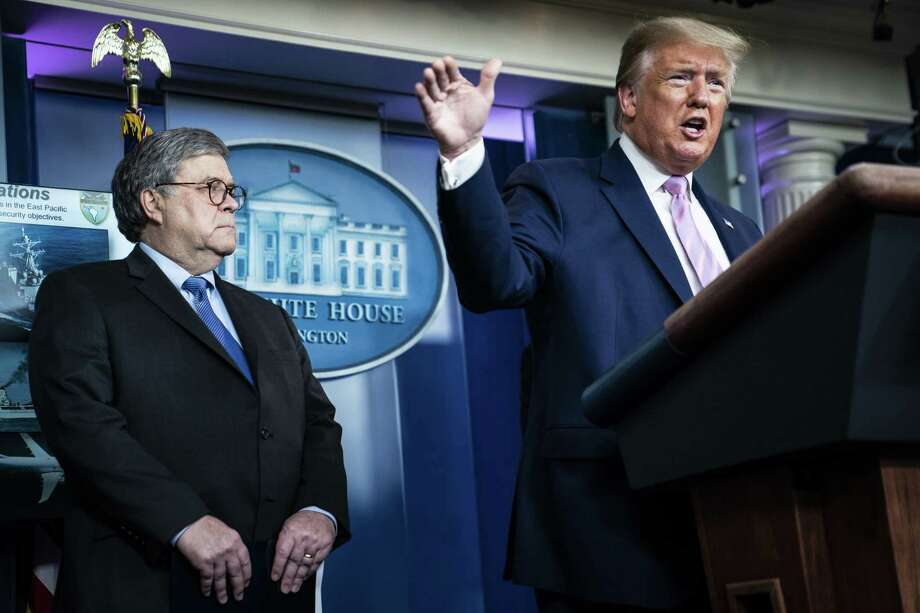 Attorney General William Barr listens as President Donald Trump speaks with members of the coronavirus task force during a briefing at the White House on April 1. Photo: Washington Post Photo By Jabin Botsford. / The Washington Post