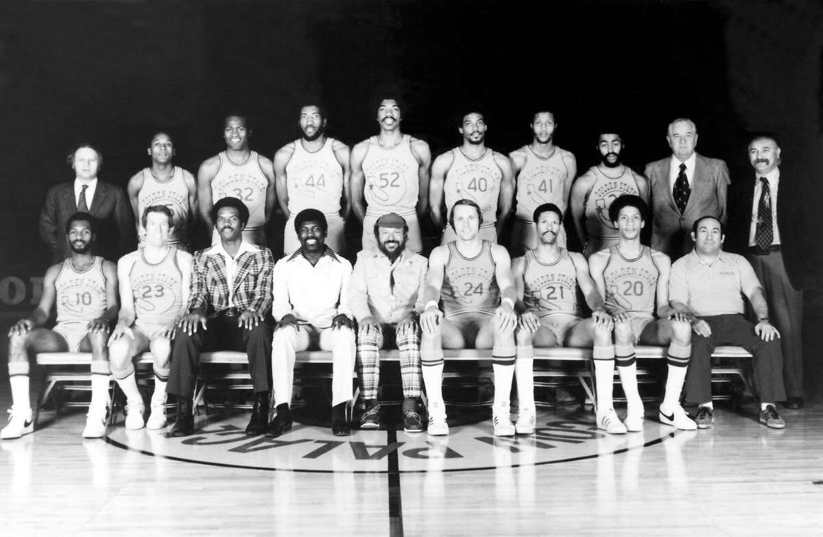 OAKLAND, CA - 1975: The World Champions of basketball Golden State Warriors pose for a team portrait front row (L-R): Charles Johnson, Jeff Mullins, Joe Roberts, Assistant Coach; Al Attles, Head Coach; Franklin Mieuli, Owner; Rick Barry, captain; Butch Beard, Phil Smith, Dick D'Oliva, Trainer. Back Row: Hal childs, Assistant General Manager; Charles Dudley, Bill Bridges, Clifford Ray, George Johnson, Derrek Dickey, Keith Wilkes, Steve Bracey, Bob Feerick, Director of Player Personnel; Dick Vertlieb, General Manager. in Oakland, California in 1975. NOTE TO USER: User expressly acknowledges and agrees that, by downloading and or using this photograph, User is consenting to the terms and conditions of the Getty Images License Agreement. Mandatory copyright notice: Copyright NBAE 2002 (Photo by NBAP/ NBAE/ Getty Images)