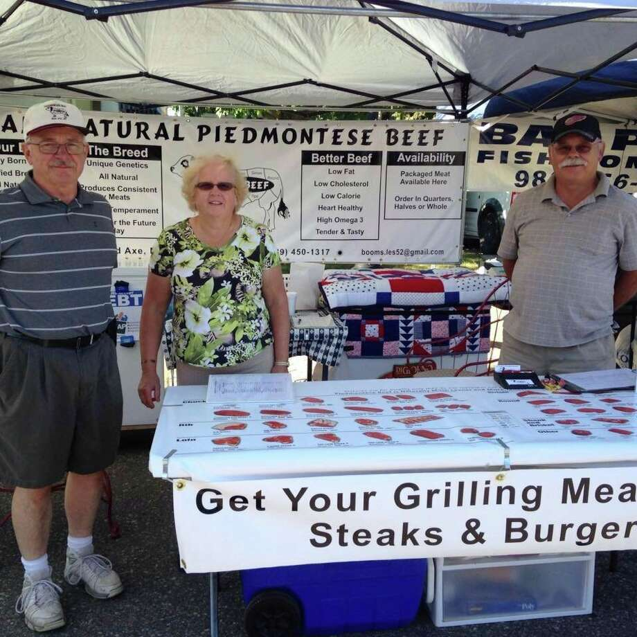 Les and Deb Boom of LDB Beef sell their meat products at a farmer's market. (Courtesy Photo)