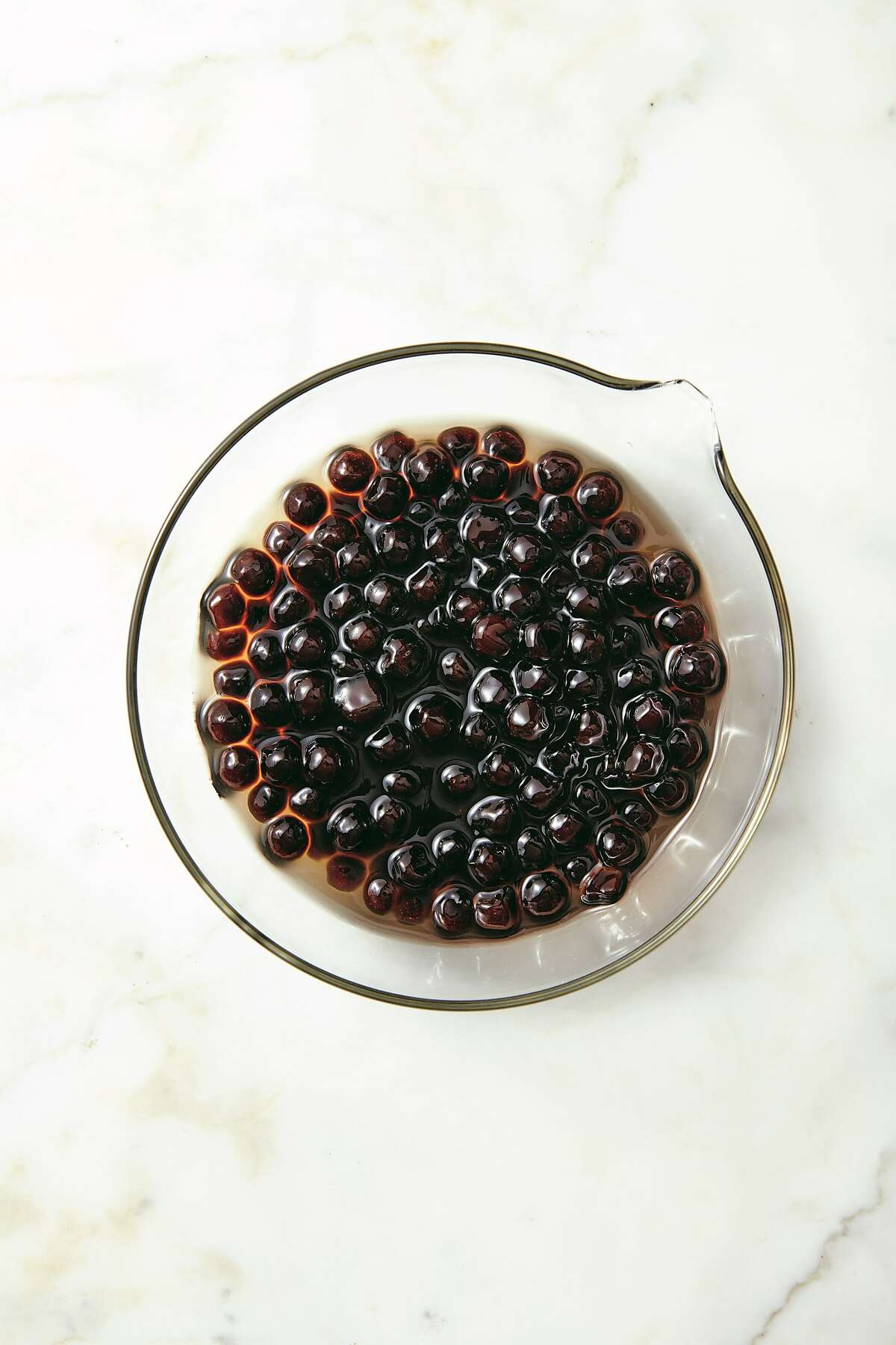 """Preparing tapioca pearls takes more than hour, including a soak in simple syrup. The recipe comes from Boba Guys founders Andrew Chau and Bin Chen's new cookbook, """"The Boba Book"""" (Clarkson Potter)."""