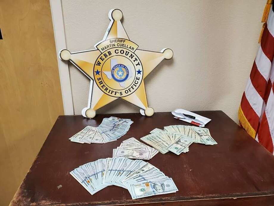Webb County Sheriff's Office deputies said they seized more than $14,000 following a traffic stop on mile marker 22 of Interstate 35. Photo: Courtesy Photo /Webb County Sheriff's Office