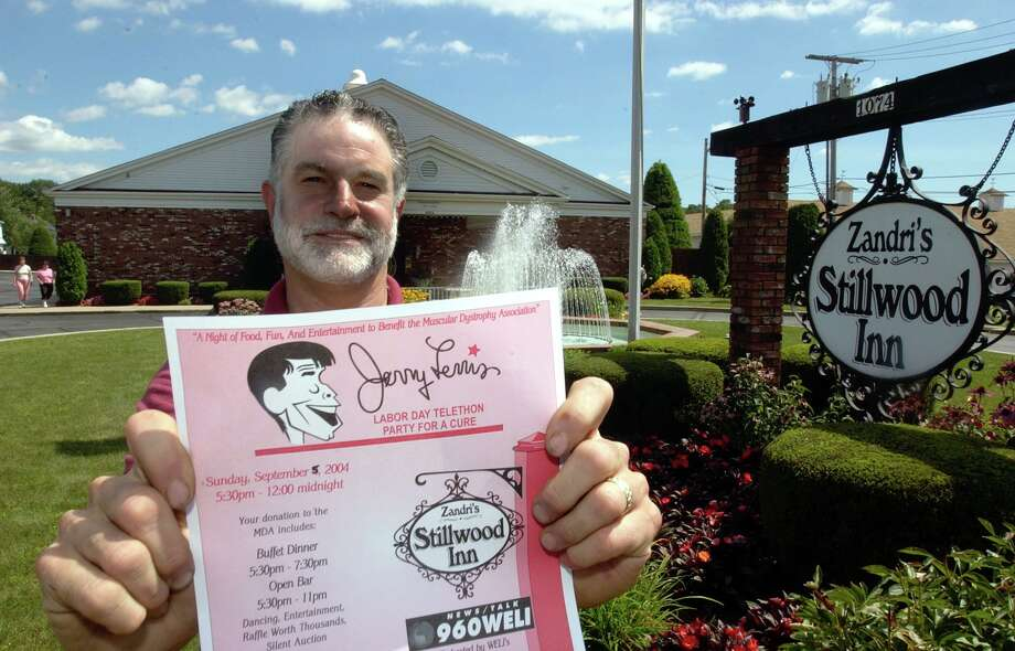 "Stillwood Inn owner Jim Zandri holds a flier for the 8th annual ""Party for the Cure"" Muscular Dystrophy Association fundraiser in 2004. Photo: Hearst Connecticut Media File"