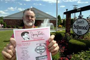 "Stillwood Inn owner Jim Zandri holds a flier for the 8th annual ""Party for the Cure"" Muscular Dystrophy Association fundraiser in 2004."