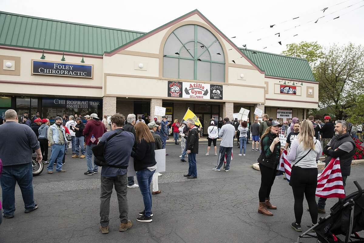 People gather in support of Atilis Gym in Bellmawr, N.J., Monday, May 18, 2020. The gym in New Jersey reopened for business early Monday, defying a state order that shut down nonessential businesses to help stem the spread of the coronavirus. (AP Photo/Matt Rourke)