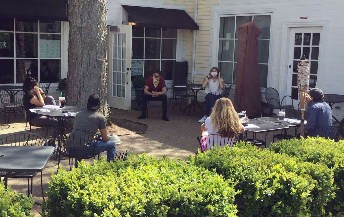 Staff at Marly's restaurant in Wilton Center discuss reopening plans.