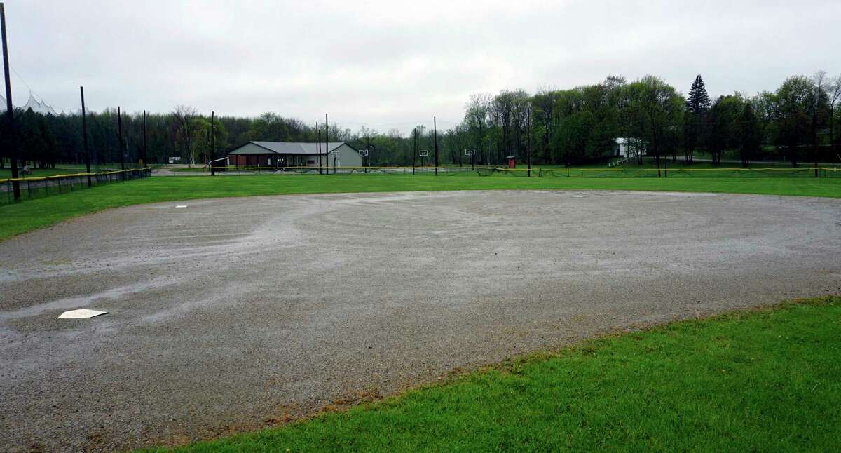 An emptydiamond at Wheatland Township park collects water two days after Chippewa Hills Little League decided to cancel its 2020 season. (Pioneer photo/Joe Judd)