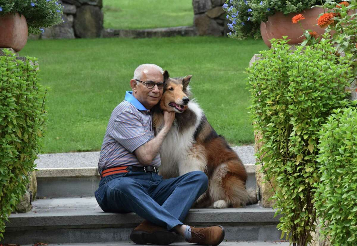 Dinyar Wadia, principal of Wadia Associates in New Canaan, enjoys some downtime with his dog, Sahdev.
