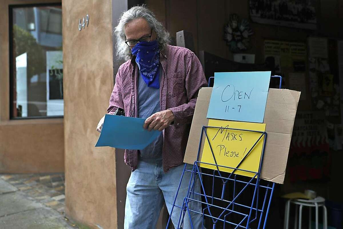 Eric Whittington, owner of Bird & Beckett Books and Records, prepares to reopen his store on Chenery Street in Glen Park neighborhood in San Francisco, Calif., on Monday, May 18, 2020. Retail stores in San Francisco and other Bay Area counties are now permitted to sell inventory curbside.