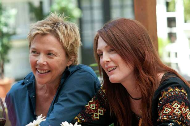 "Annette Bening, left, and Julianne Moore are shown in a scene from ""The Kids are All Right."" (AP Photo/Focus Features, Suzanne Tenner)"