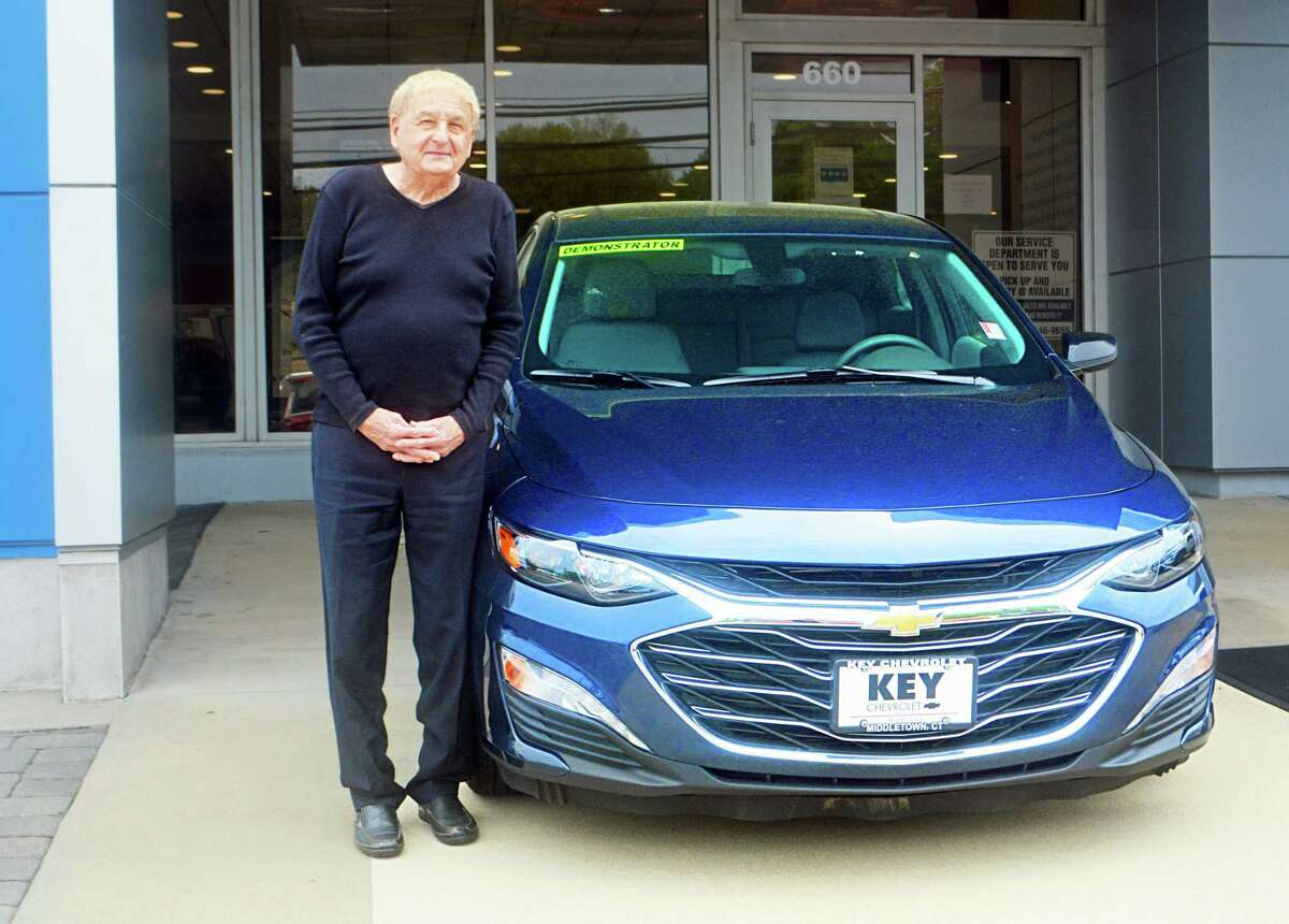 Key Chevrolet car salesman Stanley Statkiewicz approaches each customer with a smile and, in many cases, has helped two generations of families.