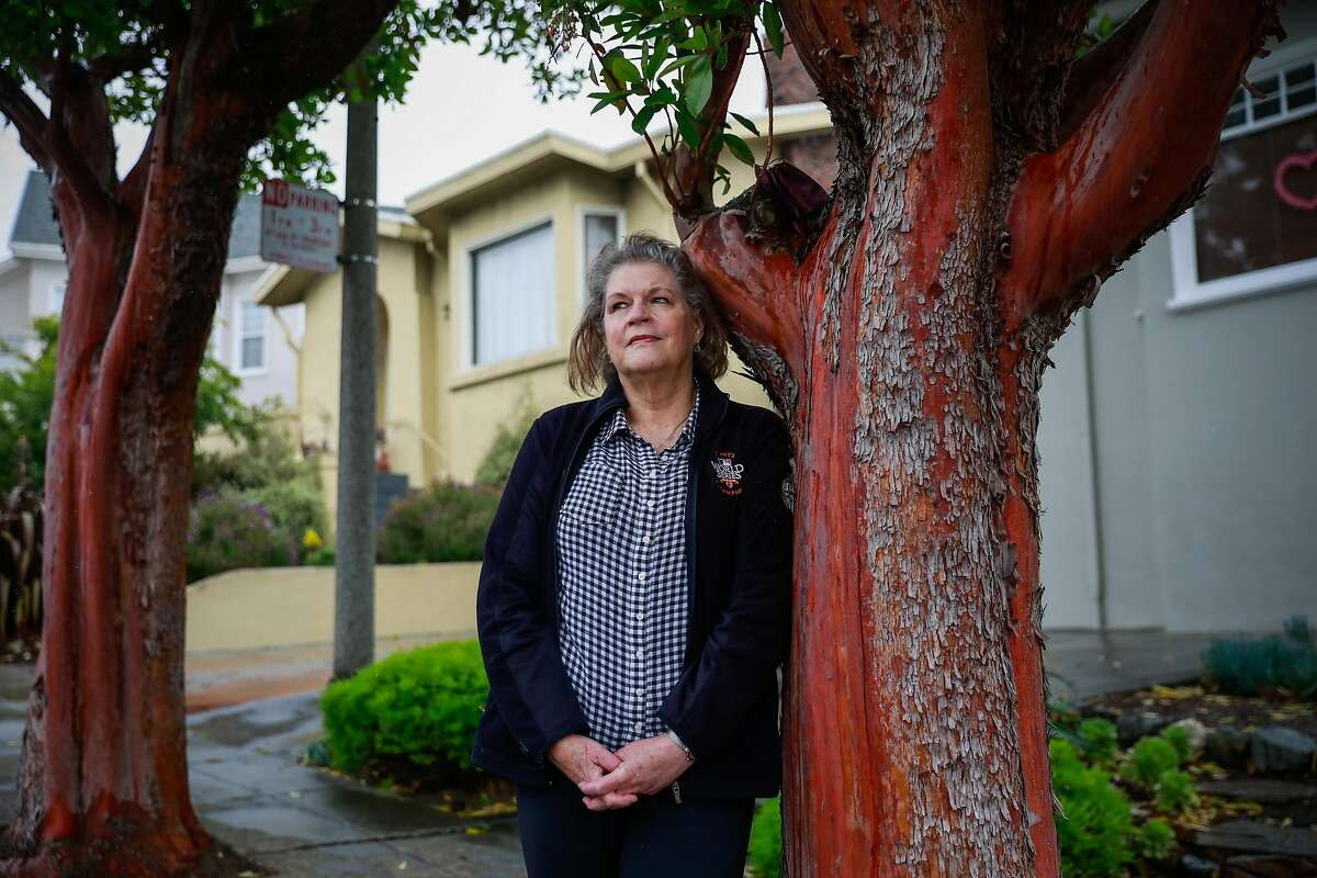 Judy Lynch stands for a portrait outside her home on Thursday, May 14, 2020 in San Francisco, California.