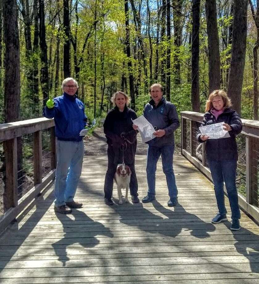 Charlie Taney, board president of the Norwalk River Valley Trail, Norma and Jim Fox with Theo and Pat Sesto, former NRVT board president, discuss plans for extending the trail in Wilton. Photo: Contributed Photo /
