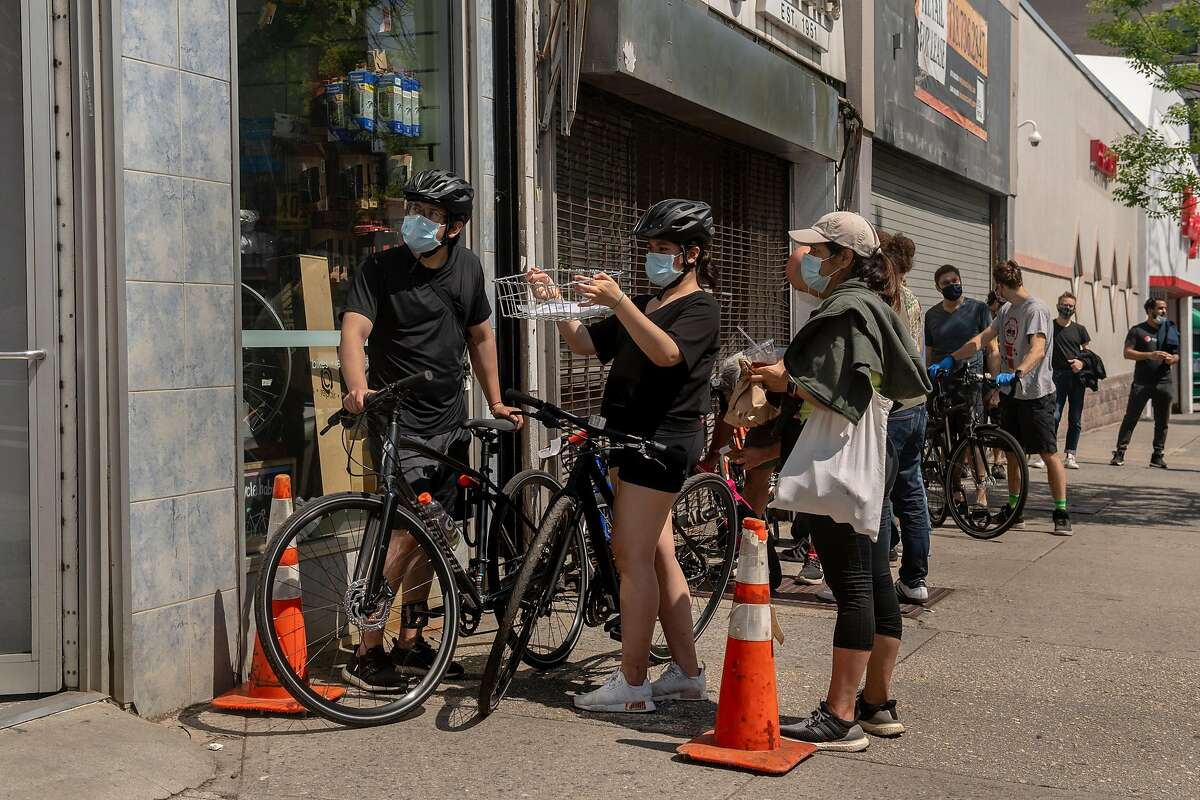 A line outside Bicycle Habitat in Brooklyn with people looking to buy bikes or have their bikes repaired in Brooklyn, Friday morning, May 15, 2020. The United States is facing a shortage of bicycles, after the coronavirus pandemic sent the demand for bikes surging. (Hilary Swift/The New York Times)