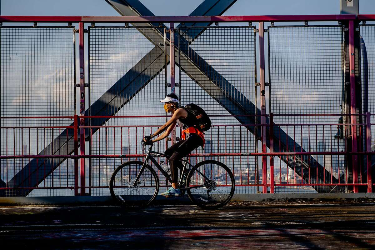 Cycling on the Williamsburg Bridge in New York, Friday, May 15, 2020. (Hilary Swift/The New York Times)