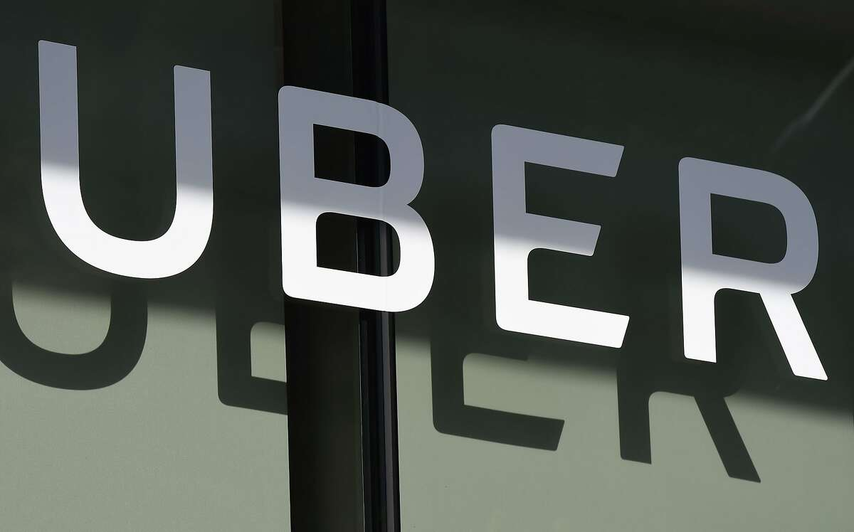 (FILES) In this file photo he Uber logo is seen at the second annual Uber Elevate Summit, on May 8, 2018 at the Skirball Center in Los Angeles, California.