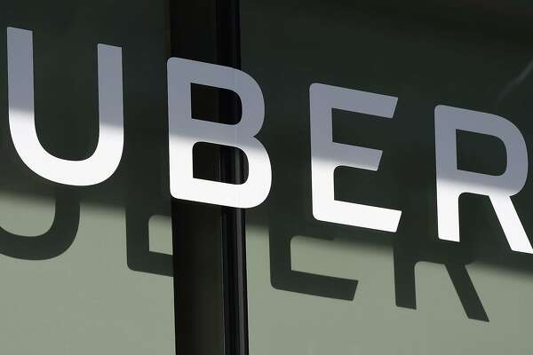 (FILES) In this file photo he Uber logo is seen at the second annual Uber Elevate Summit, on May 8, 2018 at the Skirball Center in Los Angeles, California. - Uber on May 18, 2020 announced it is cutting a quarter of its global workforce and trimming investment to survive the financial hit to its business from the coronavirus pandemic. The San Francisco-based company is laying off about 3,000 people and stopping some investments unrelated to its core ride-share and delivery businesses, according to chief executive Dara Khosrowshahi. (Photo by Robyn Beck / AFP) (Photo by ROBYN BECK/AFP via Getty Images)