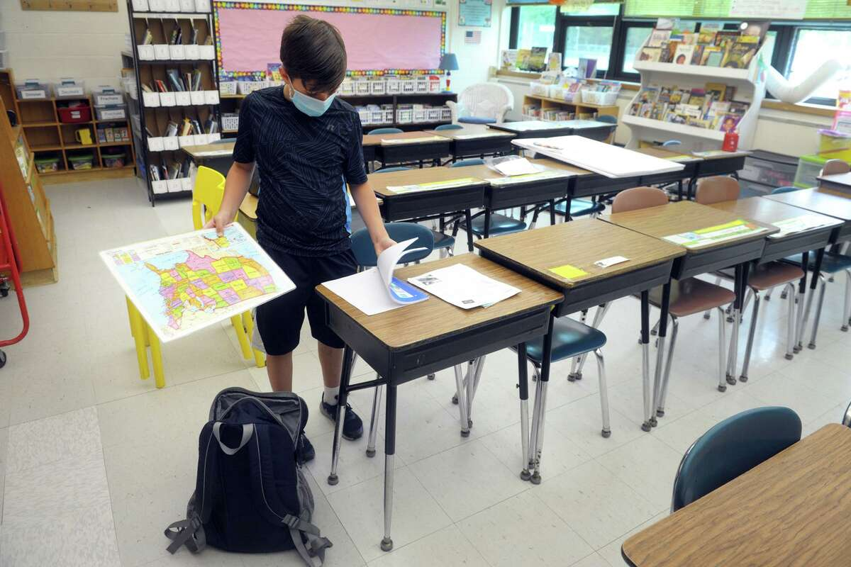 Fourth-grader Jackson Betts cleans out his desk at Sunnyside School in Shelton.
