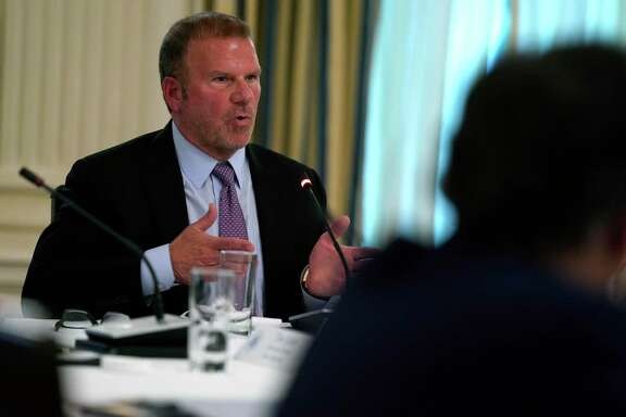 Tilman Fertitta, chairman and CEO of Landry's Inc., speaks during a meeting with restaurant industry executives about the coronavirus response, in the State Dining Room of the White House, Monday, May 18, 2020, in Washington. (AP Photo/Evan Vucci)