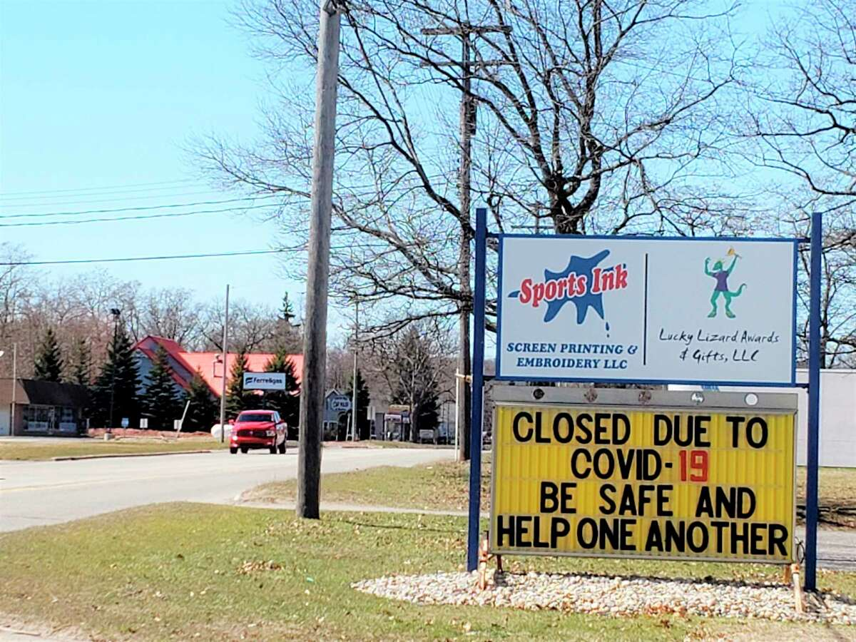 Some businesses around Manistee County feature changed signs to let customers know they are closed or have different services or hours due to the COVID-19 pandemic. Monday, Michigan's governor announced certain retail businesses would be allowed to open starting Friday and with stipulations such as limiting capacity to 50%. (File photo)